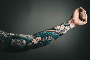 Tatouage homme bras rock